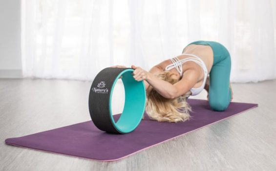 childs pose yoga wheel